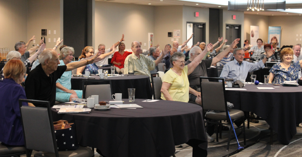 parkinson's group raising hands at event