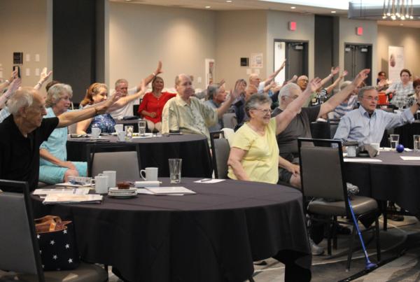 parkinson's group raising hands at event